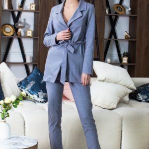 Купить женский костюм из стрейч-джинса голубого цвета