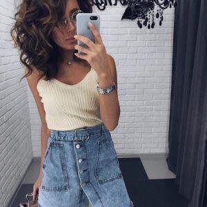 Заказать в подарок женскую джинсовую юбку с пуговицами и поясом джинсового цвета недорого