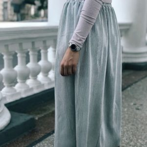 Приобрести дешево плиссированную женскую юбку из вискозы на резинке металлического цвета оптом Украина