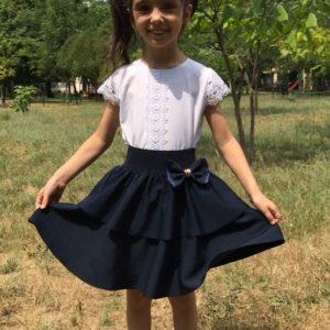 Заказать в подарок юбку с бантом школьную детскую на резинке двухслойная клеш черного цвета дешево
