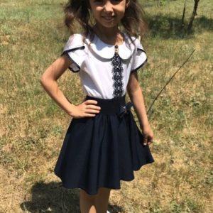 Приобрести недорого юбку детскую школьную клеш на резинке с подкладкой черного цвета оптом Украина