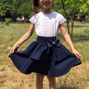 Приобрести недорого юбку детскую школьную двухслойная клеш на резинке с бантом синего цвета оптом Украина