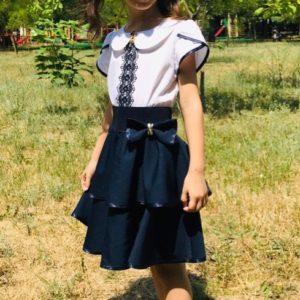 Приобрести недорого юбку детскую школьную на резинке с баской клеш для девочек синего цвета оптом Украина