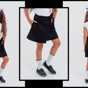 Приобрести недорого юбку с запахом детскую школьную из трикотажа итальянского с поясом для девочек черного цвета оптом Украина
