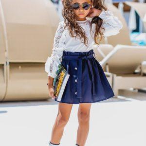 Заказать в подарок детскую школьную юбку легкую на пуговицах для девочек цвета синего дешево