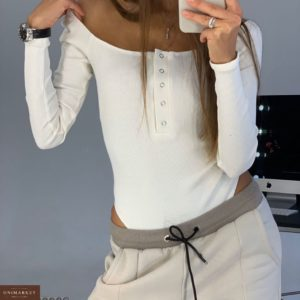 Приобрести в интернет-магазине женский боди из трикотажа в рубчик с пуговицами молочного цвета дешево