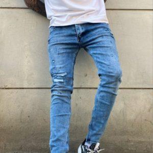 Купить мужские голубые светлые зауженные джинсы с рваными вставками по низким ценам