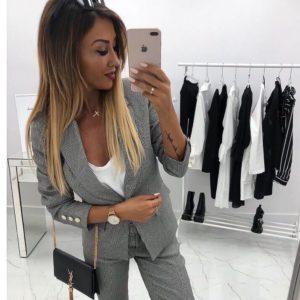 Придбати жіночий брючний костюм в чорно-білу клітинку (розмір 42-48) вигідно