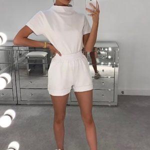 Купить белый женский трикотажный костюм с воротником-стойкой дешево