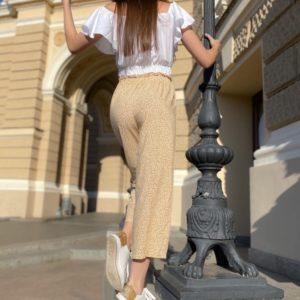 Заказать бежевые укороченные брюки для женщин из штапеля с принтом по специальным предложениям