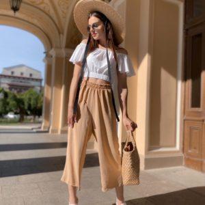 Купить бежевые широкие штаны из американского крепа для женщин на резинке на лето выгодно