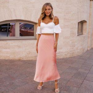 Заказать женскую (размер 40-48) розовую шёлковую юбку миди длины по скидке