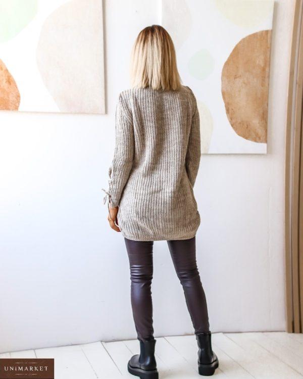 Приобрести женский удлиненный вязанный свитер с завязкой (размер 42-54) по низким ценам бежевого цвета