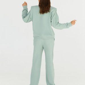 Приобрести на осень прогулочный костюм с подплечниками из трехнитки для женщин цвета фисташка дешево