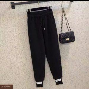 Заказать черные (размер 42-50) спортивные женские штаны с асимметричными манжетами недорого