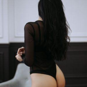 Приобрести недорого женское боди с длинным рукавом из сетки черного цвета