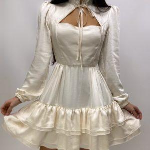 Купить молочного цвета шелковое женское платье с рюшами и завязкой онлайн