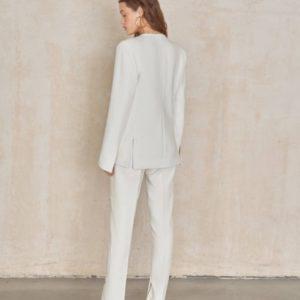 Заказать белые женские брюки со шлицей по скидке