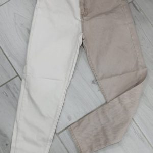 Приобрести недорого бежевые джинсы свободного кроя с белой штаниной для женщин