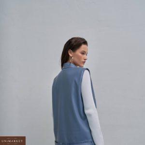 Приобрести недорого голубую жилетку из эко кожи с накладными карманами для женщин
