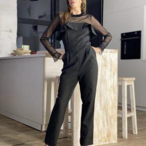 Заказать женский брючный черный комбинезон с рюшами и сеткой онлайн
