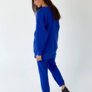 Приобрести по скидке цвета электрик спортивный костюм свободного кроя женский однотонный (размер 42-50) дешево