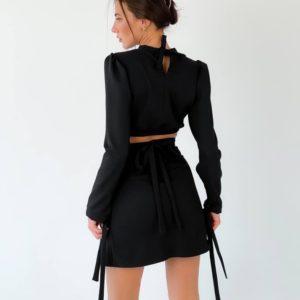Заказать недорого женский костюм: закрытый топ с юбкой мини черного цвета в Украине