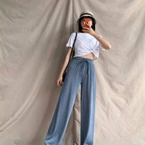 Заказать онлайн женские свободные штаны цвета джинс из летнего трикотажа