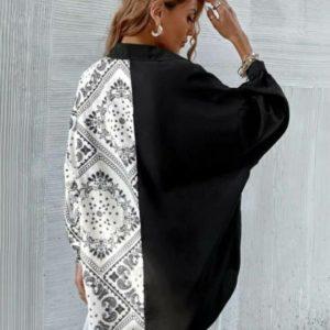 Придбати чорно-білого кольору жіночу двобарвну блузу з принтом (розмір 42-48) дешево