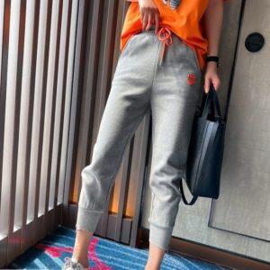 Заказать серые женские спортивные штаны со змейками по скидке