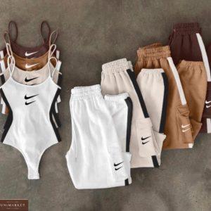 Заказать онлайн белый, беж, кемел, черный костюм Nike со штанами с боди недорого для женщин
