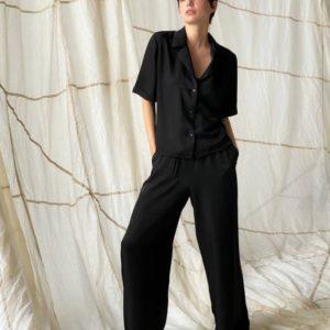 Заказать черный женский свободный брючный костюм (размер 42-48) по низким ценам