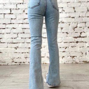 Приобрести выгодно голубые джинсы с разрезами спереди для женщин