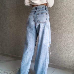 Приобрести выгодно голубые джинсы с разрезами для женщин