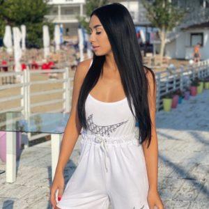 Купити білий жіночий костюм двійка Nike: боді + шорти за низькими цінами