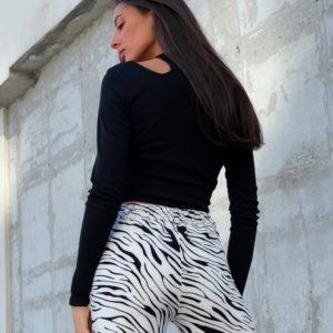 Заказать женские брюки онлайн с принтом зебра (размер 42-50) черно-белые