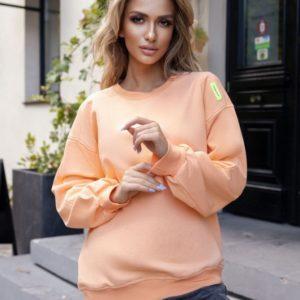 Замовити вигідно помаранчевий світшот з нашивкою для жінок