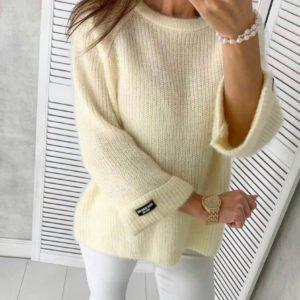Заказать по низким ценам женский однотонный вязаный свитер (размер 42-48) молочный